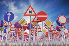 Many road signs against blue sky. 3D rendered illustration.  Stock Image