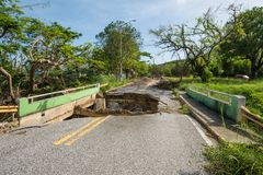 Washout on Puerto Rico road in Caguas, Puerto Rico. Many roads were destroyed by Hurricane Maria in September, 2017 and by the resulting flooding and soil Royalty Free Stock Photo
