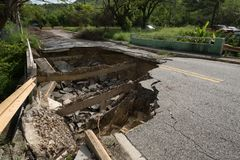 Washout on Puerto Rico road in Caguas, Puerto Rico. Many roads were destroyed by Hurricane Maria in September, 2017 and by the resulting flooding and soil Royalty Free Stock Image