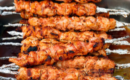 Many roast meat on skewers portions Royalty Free Stock Image