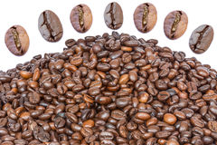 Many roasted coffee beans. On white background Stock Photo