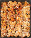 Many roasted spicy chicken wings on hot tray Stock Photography