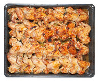 Many roasted spicy chicken wings on tray isolated Stock Photos