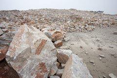 Many rock and stones at quarry field Royalty Free Stock Photos