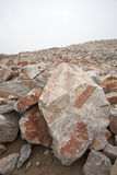Many rock and stones at quarry field Royalty Free Stock Images
