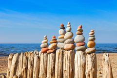 Many of the Rock zen pyramid of white and pink pebbles on a back stock images