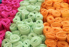 Many rolls of colored felt for sale in the market. Stall of fabrics Royalty Free Stock Photos