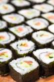 Many rolls with salmon close-up Stock Photos