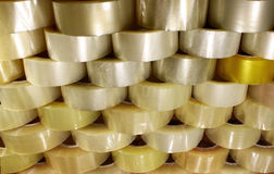 Many rolls of transparent packing sticky tape.  Stock Image