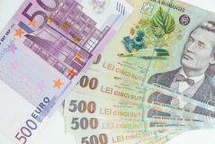 Many romanian leu high banknotes and 500 euro bill. Concept photo Royalty Free Stock Photos