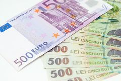Many romanian leu high banknotes and 500 euro bill. Concept photo Royalty Free Stock Images