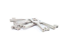 Many room keys. Isolated on white background royalty free stock image