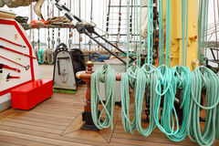 Many ropes, windlass and rigging on an ship. With wooden deck Stock Images