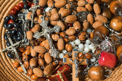 Many Rosary Beads with Crucifixes Stock Photo
