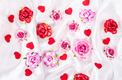 Many of roses and red heart. Stock Photos