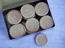 Many round biscuit in the tin Stock Image