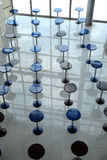 Many round eating tables in empty cafe hall vertical view abstract Stock Image