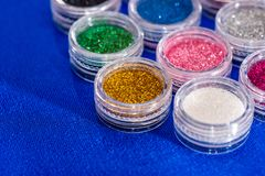 Many round jars with multi-colored bright glitter royalty free stock photo