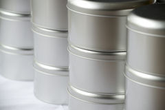 Many round tin boxes Stock Images