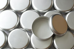 Many round tin boxes Royalty Free Stock Photo