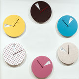 Many round wall clocks that mark the passage of time Stock Images