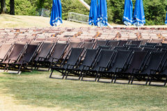 Many rows of empty lawn chairs in park Royalty Free Stock Photography