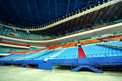 Many rows of empty plastic seats of grandstand Stock Image
