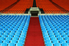 Many rows of empty plastic seats at stadium Stock Images
