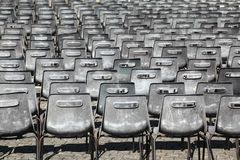 Many rows of gray chairs outdoor Stock Photography