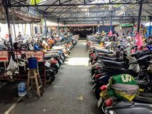 Many rows of motorbikes parked at a market in Hanoi, Vietnam stock images