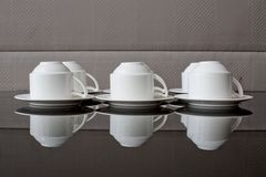 Many rows of pure white cup and saucer Stock Photo
