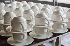 Many rows of pure white cup and saucer Royalty Free Stock Photo