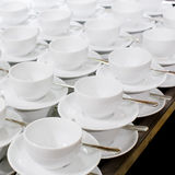 Many rows of pure white cup and saucer designed in vintage retro Royalty Free Stock Images