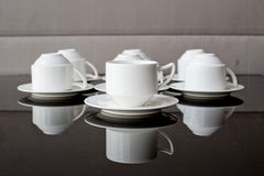 Many rows of pure white cup and saucer Royalty Free Stock Photography