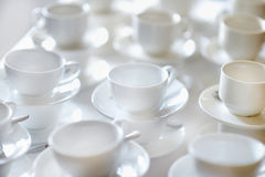 Many rows of pure white cups and saucers Royalty Free Stock Photos