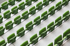 Many rows of seats in big empty stadium Stock Images