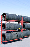 Many rubber tires on a rack Royalty Free Stock Photos