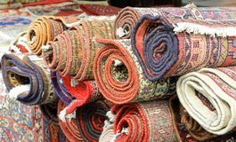 Many Rugs And Carpets At Stand Royalty Free Stock Image