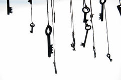 Many rustic keys hanging on string. Selective focus. Isolated Stock Image