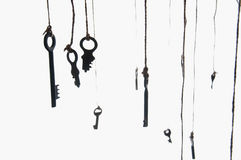 Many rustic keys hanging on string. Selective focus. Isolated.  Stock Photography