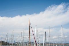 Many sailing boat mast on blue sky Stock Photos