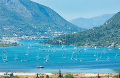 Many sailing vessels in bay (Nydri, Lefkada, Greece). Many sailing vessels in bay. Hazy summer Lefkada coast landscape (Nydri, Greece, Ionian Sea Royalty Free Stock Images