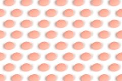 Salmon pink pills isolated on white Royalty Free Stock Photography