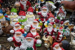Many santa claus figures, funny christmas background Royalty Free Stock Images
