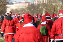 Many Santa Claus with red dress. At Christmas stock photography