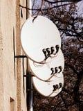 Many satellite dishes stock photography