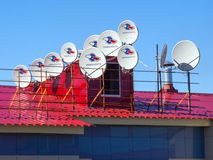 Many satellite dishes are installed on the roof royalty free stock photography