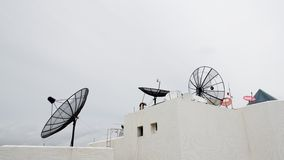 Many satellite dishes on the roof Royalty Free Stock Image