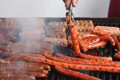 Many sausages on grill Stock Image