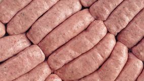 Many Sausages Rotating. Raw sausages turning slowly macro shot stock footage